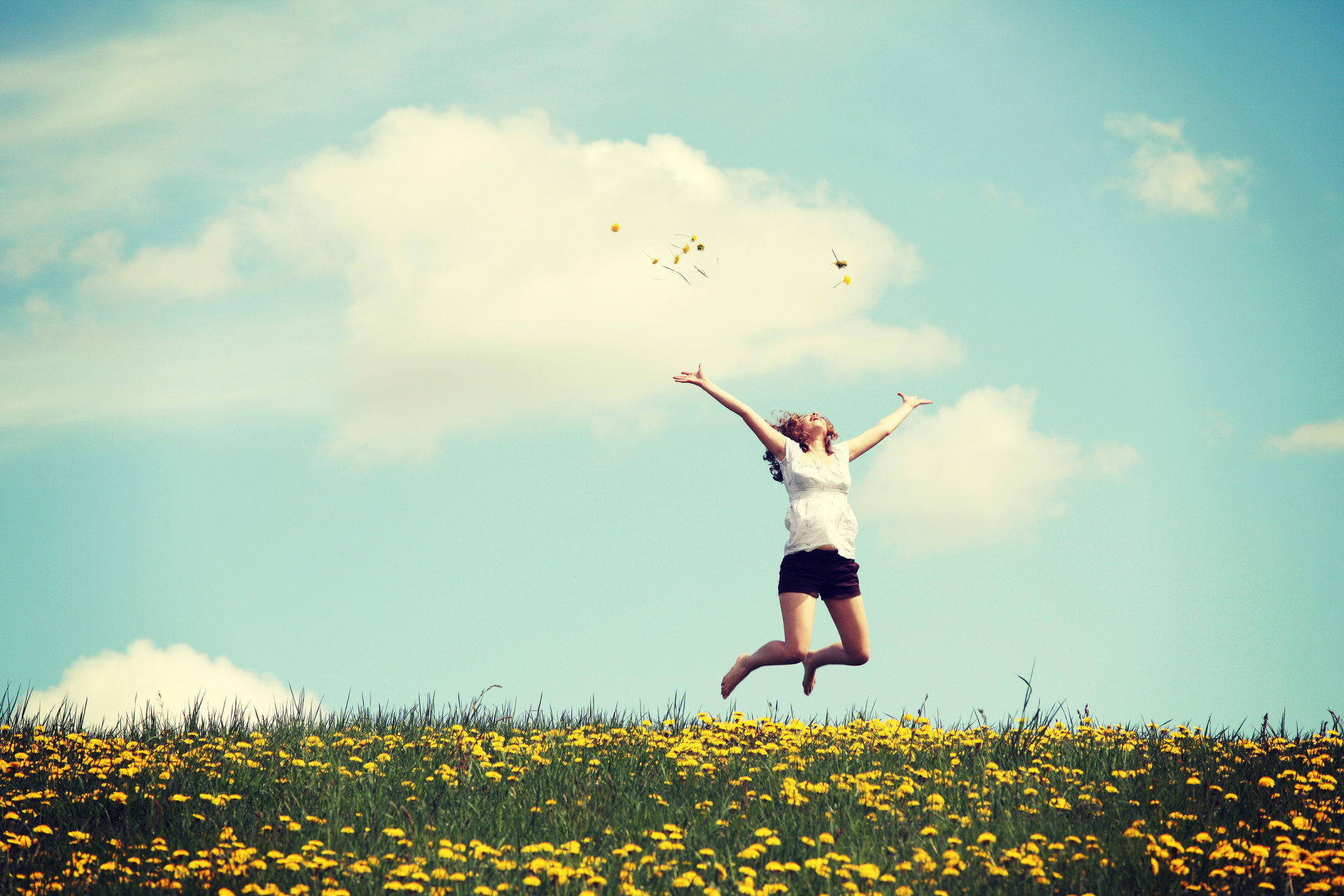 bigstock Happy woman jumping on blossom 59295572 - Home